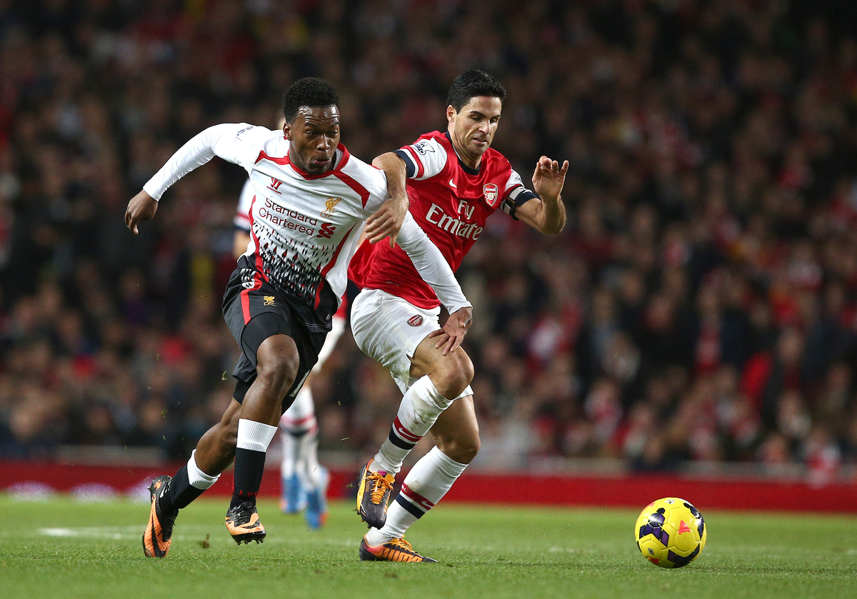 Daniel Sturridge of Liverpool and Mikel Arteta of Arsenal in action