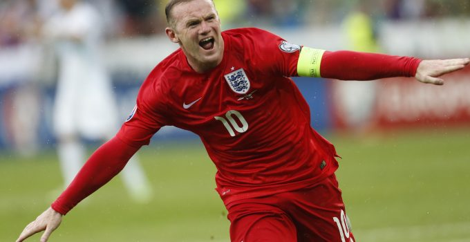 England's Wayne Rooney celebrates his goal during the Euro 2016 Group E qualifying soccer match between Slovenia and England, in Ljubljana, Slovenia, Sunday, June 14, 2015. (AP Photo/Darko Bandic)